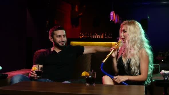 Couple Smoke From Shisha Pipe