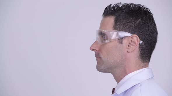 Thumbnail for Head Shot Profile View of Handsome Man Doctor Wearing Protective Glasses
