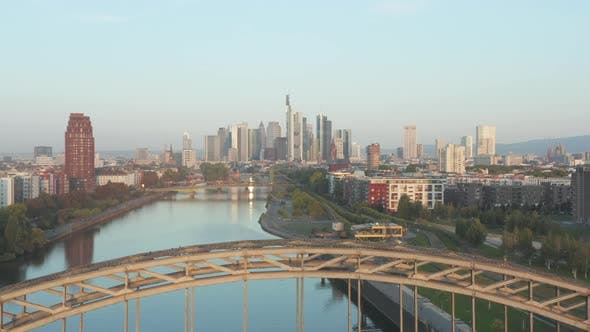 Frankfurt Am Main, Germany Skyscraper Skyline View Slow Dolly Out Revealing Bridge Over Main River