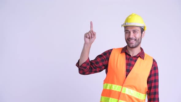 Thumbnail for Happy Bearded Persian Man Construction Worker Thinking and Pointing Up
