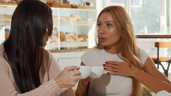 Thumbnail for Female Friends Gossiping, Discussing Shocking News Over Cup of Coffee