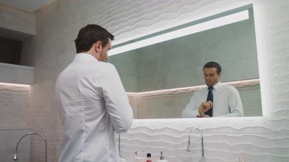 Thumbnail for Business Man Setting Tie in Luxury Bathroom. Happy Man Wearing Necktie in House