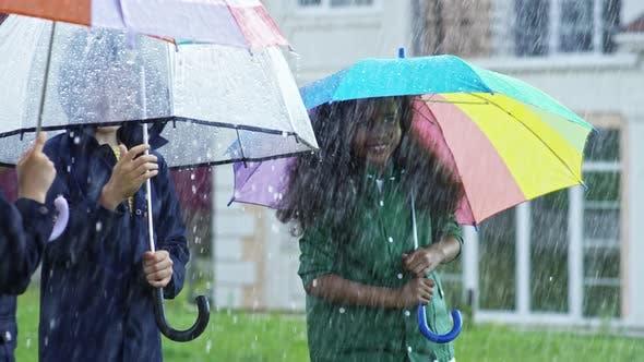 Thumbnail for Happy Children Walking in Heavy Rain