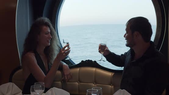 Young Beautiful Couple Having Romantic Dinner on Cruise Ship.