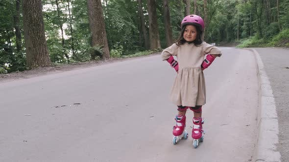 Thumbnail for Cute Girl in Safety Equipment Is Standing on the Road