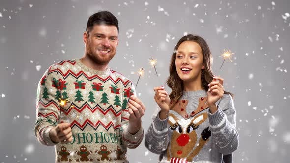 Thumbnail for Happy Couple with Sparklers at Christmas Party