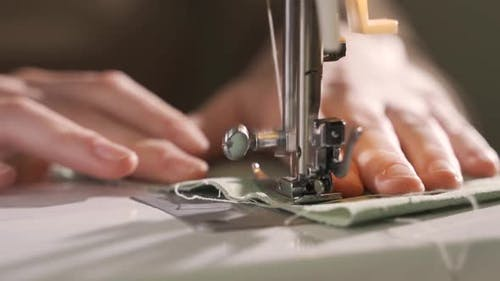 The Sewing Machine is Sewing Lightcolored Linen