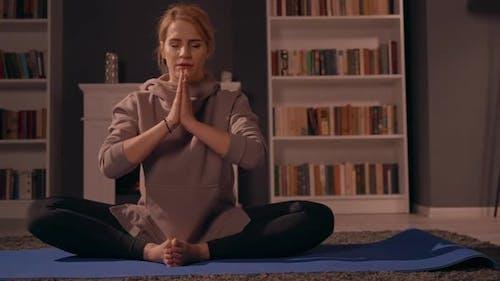 Female Doing Yoga in Living Room