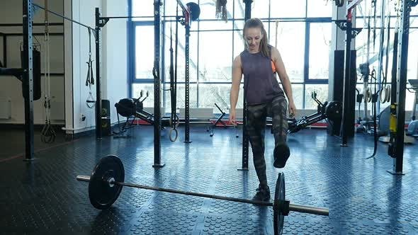 Thumbnail for Muscular Sports Woman Finish to Work Out in the Gym Lifting Weights.