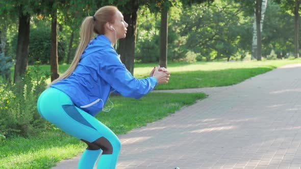 Thumbnail for Athletic Fit Woman Doing Squats Outdoors in the Morning