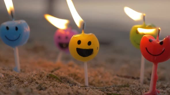 Thumbnail for Colorful Smiley Candles on the Beach