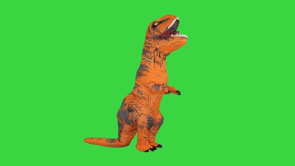 Funny Dancing of a Man in a Dinosaur Costume on a Green Screen Chroma Key