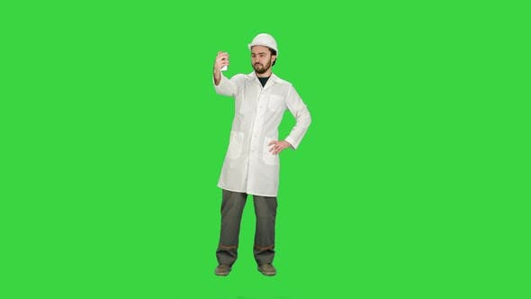 Thumbnail for Engineer or Architect Taking a Selfie Showing Gesture on a Green Screen, Chroma Key