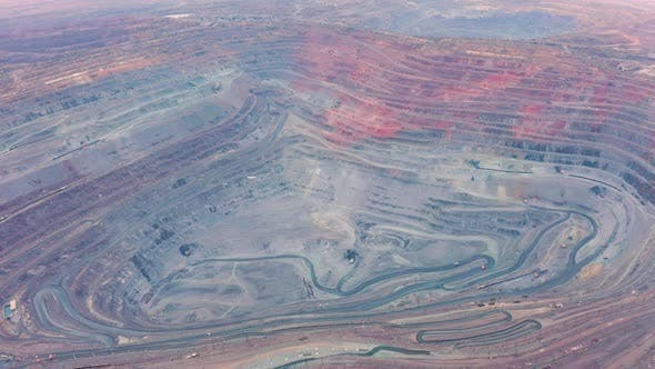 Thumbnail for Aerial View of Opencast Mining Quarry with Lots of Machinery at Work - View From Above.