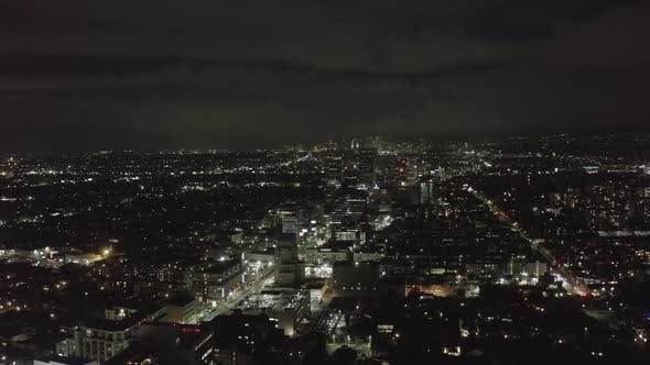 Thumbnail for AERIAL: Over Dark Hollywood Los Angeles at Night with View on Skyline and City Lights