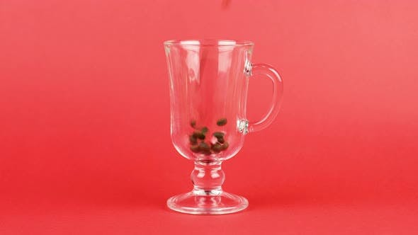 Thumbnail for Coffee Beans Quickly Pour, Latte Glass Cup, Red Background. Energy Concept