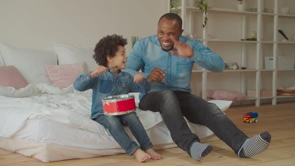 Thumbnail for Diverse Family Enjoying Leisure Playing Toy Drum