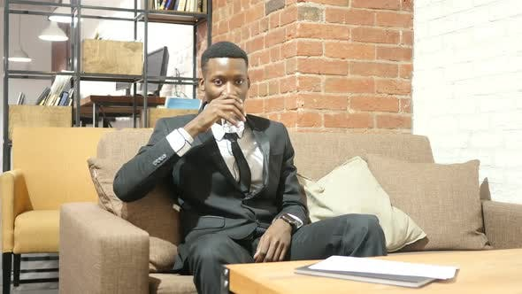 Thumbnail for Black Businessman Drinking Water, Sitting in Office