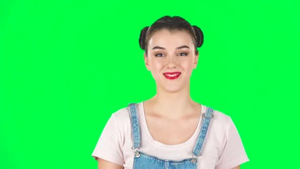 Thumbnail for Portrait of Smiling Girl with Two Hair-buns on Green Screen. Slow Motion