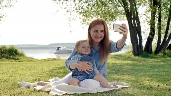 Thumbnail for Young Mother with Toddler Taking Selfie