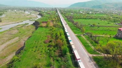 Highway In Caucasus Mountains With Hundreds Of Trucks Standing