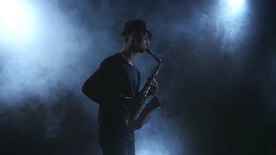 On Dark Smoky Studio Improvisation Jazz Music on Saxophone