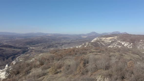 Thumbnail for Panning on landscape with Deli Jovan Krsh and Stol mountains in distance 4K drone video