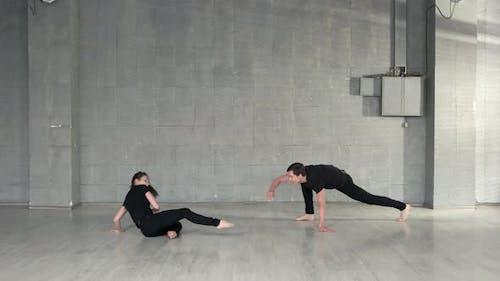Skillful Dancers Practicing Modern Dance in Studio