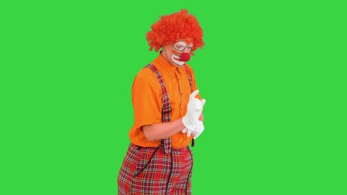 Clown Using Imaginary Digital or Virtual Screen on a Green Screen Chroma Key