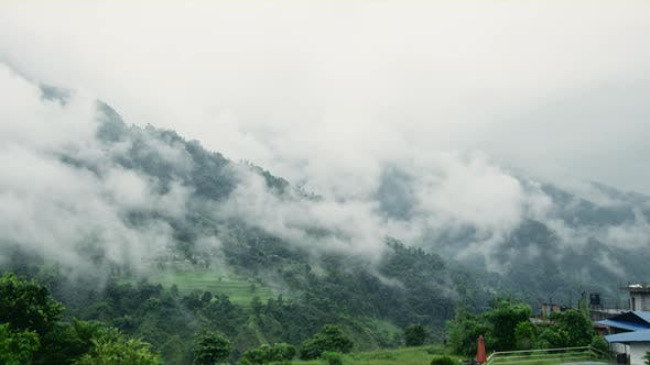 Thumbnail for A Foggy Mountain Landscape in Nepal with the Glimpse of its Suburban Life