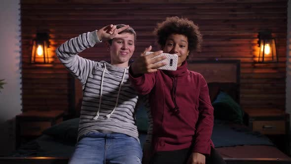 Cover Image for Smiling Mixed Race Teens Posing for Selfie Indoors