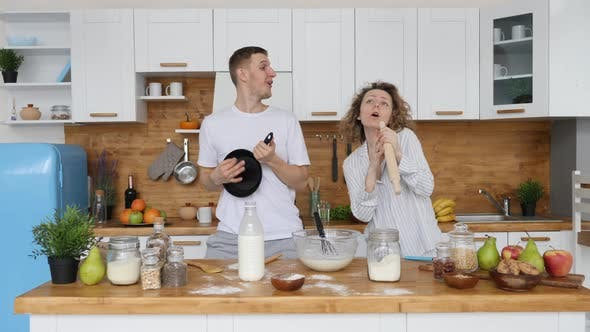 Thumbnail for Family, Relationship, Happiness, Happy Lifestyle Concept, Couple Dancing In Kitchen