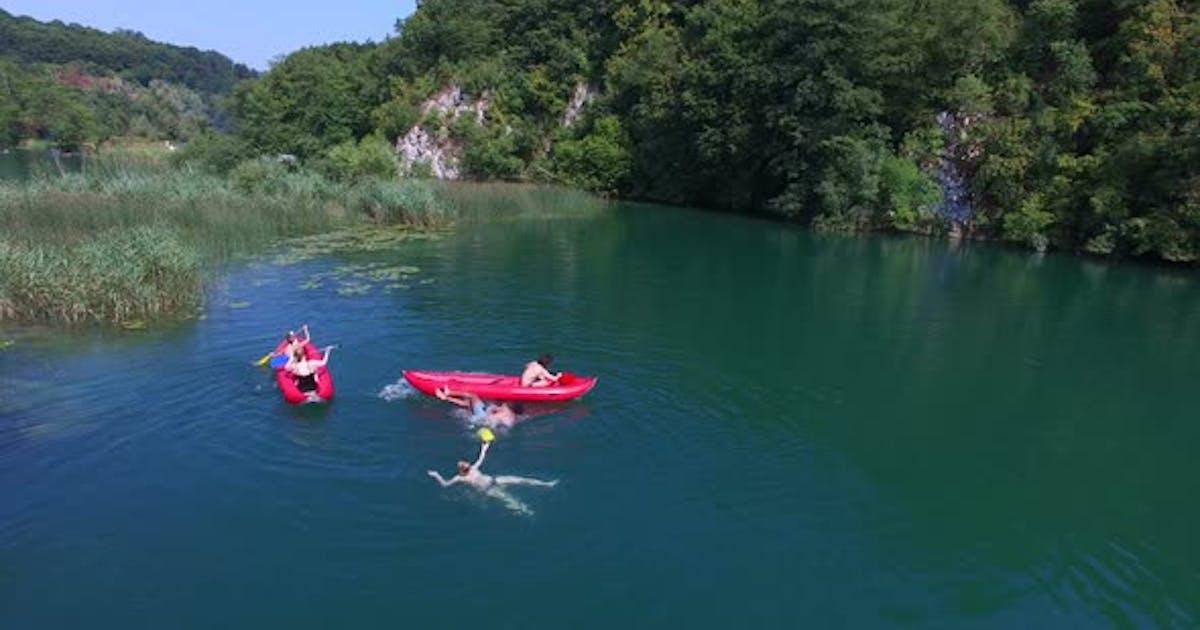 Friends having fun in canoe on Mreznica river, Croatia