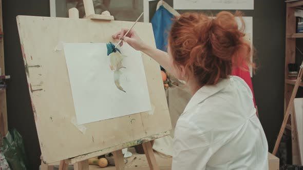 Thumbnail for Young Female Artist Painting Still Life in Studio