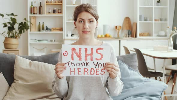 Thumbnail for Woman Holding Poster with «NHS thank you heroes» Sign and Posing for Camera