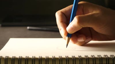 Hand drawing a flat line with a black pencil