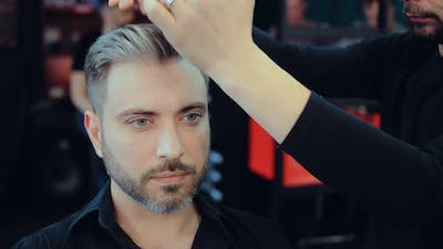 Man Doing Styling in a Barber Shop