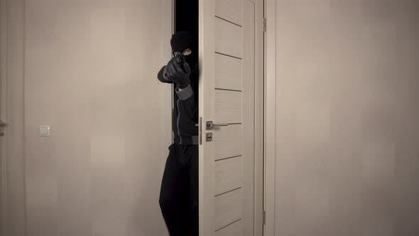 Thumbnail for The Robber Climbed Into the House. The Masked Bandit Neatly Went Through the Door To the Room Aiming