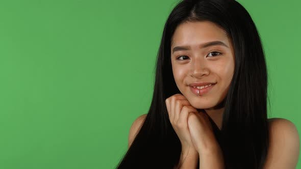 Thumbnail for Stunning Beautiful Asian Woman Looking Cute and Happy on Green Backgorund