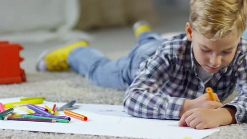 Schoolboy Drawing Picture on the Floor