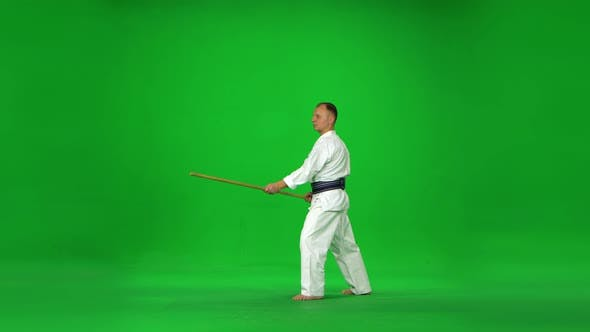 Thumbnail for Masculine Kendo Master on White Kimono Warrior Practicing Martial Art with the Bamboo Bokken on