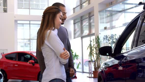 Thumbnail for Couple Chooses Car at the Dealership