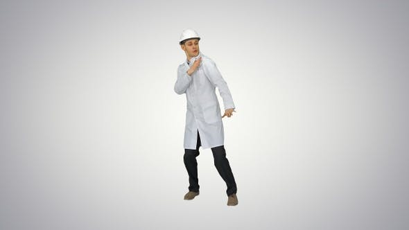 Thumbnail for Funny scientinst in white robe and safety helmet dancing
