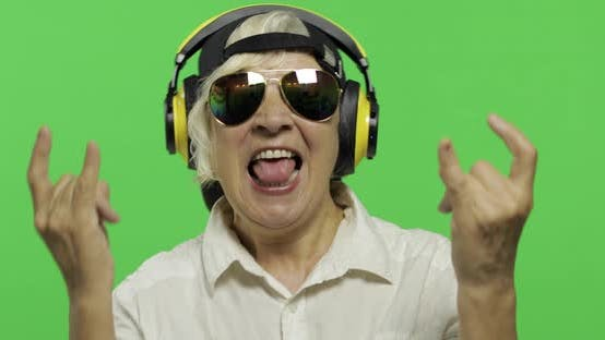 Thumbnail for Elderly Woman Listens To Music in Headphones and Dances. Grandmother. Chroma Key