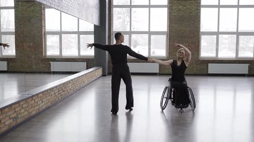Exciting Dancing Couple Training in Dance Hall