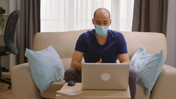 Thumbnail for Man with Protection Mask on a Business Video Call