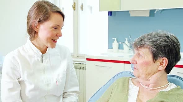 Thumbnail for Close up of female dentist and elderly female patient talking