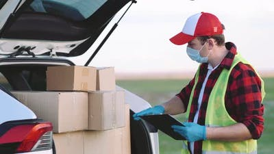 Young Delivery Man Checking List