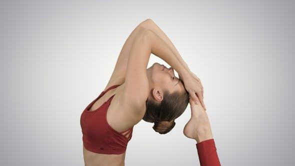Thumbnail for Beautiful young woman doing yoga exercise Eka Pada Rajakapotasana