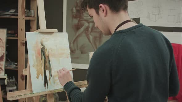 Thumbnail for Young Student Painting Picture with Oils and Holding Palette